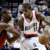 Portland Trail Blazers forward LaMarcus Aldridge, right, works the ball against Miami Heat center Chris Bosh during the first quarter of an NBA basketball game in Portland, Ore., Thursday, Jan. 10, 2013. (AP Photo/Don Ryan)