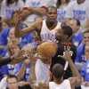 Oklahoma City\'s Kevin Durant (35) passes the ball over Miami\'s Chris Bosh (1) to Serge Ibaka (9) during Game 2 of the NBA Finals between the Oklahoma City Thunder and the Miami Heat at Chesapeake Energy Arena in Oklahoma City, Thursday, June 14, 2012. Photo by Chris Landsberger, The Oklahoman