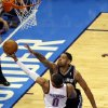 Oklahoma City\'s Russell Westbrook (0) goes up for a basket as San Antonio\'s Tim Duncan (21) defends during Game 3 of the Western Conference Finals in the NBA playoffs between the Oklahoma City Thunder and the San Antonio Spurs at Chesapeake Energy Arena in Oklahoma City, Sunday, May 25, 2014. Photo by Nate Billings, The Oklahoman