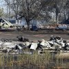 The remains of Harold and Vicky Grigg\'s home and outbuildings at 6830 132nd Street still smolder from Friday\'s wildfire on Saturday, Aug. 4, 2012, in Slaughterville, Okla. Photo by Steve Sisney, The Oklahoman