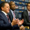 Cleveland Cavaliers owner Dan Gilbert, left, speaks alongside new head coach Mike Brown, center, and general manager Chris Grant, right, during an NBA basketball news conference, Wednesday, April 24, 2013, in Independence, Ohio. Brown, who led the Cavs to the NBA playoffs in each of his five seasons with the club, has reunited with a team and owner who fired him after Cleveland was eliminated from the 2010 playoffs. (AP Photo/Jason Miller)