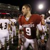 Photo - Oklahoma's Trevor Knight (9) shakes hands with Warhawks players following the college football game where the University of Oklahoma Sooners (OU) play the University of Louisiana Monroe Warhawks at Gaylord Family-Oklahoma Memorial Stadium in Norman, Okla., on Saturday, Aug. 31, 2013. Photo by Steve Sisney, The Oklahoman