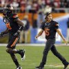 Rickie Fowler walks off the field with Oklahoma State\'s Justin Blackmon (81) before the Fiesta Bowl between the Oklahoma State University Cowboys (OSU) and the Stanford Cardinal at the University of Phoenix Stadium in Glendale, Ariz., Monday, Jan. 2, 2012. Photo by Sarah Phipps, The Oklahoman