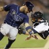 Photo - Tampa Bay Rays' Sean Rodriguez is tagged out by Detroit Tigers catcher Bryan Holaday during the seventh inning of a baseball game in Detroit, Sunday, July 6, 2014. (AP Photo/Carlos Osorio)