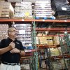 Photo -   In this Monday, July 30, 2012 photo, Dave Krepco, director of the Second Harvest Food Bank, checks on inventory at the food bank warehouse in Orlando, Fla. In the past four years, food distribution to 500 pantries, shelters, and other relief agencies in the six-county area has jumped about 60 percent. In the last year alone, that amounted to 36 million pounds of food. Krepcho estimates about 30 percent of those seeking help are first-timers. They're blue-collar and white-collar, many middle class, even some upper middle class. They include college-educated couples and professionals. (AP Photo/John Raoux)