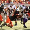 Photo - Oklahoma State linebacker Ryan Simmons, left, tackles Kansas State quarterback Daniel Sams, right, during the second half of an NCAA football game in Stillwater, Okla., Saturday, Oct. 5, 2013. Oklahoma State won 33-29. (AP Photo/Brody Schmidt)
