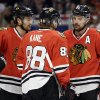 Chicago Blackhawks\' Patrick Sharp (10) talks with teammates Duncan Keith (2) and Patrick Kane (88) during the second period of Game 1 of an NHL hockey playoffs Western Conference semifinal against the Detroit Red Wings in Chicago, Wednesday, May 15, 2013. (AP Photo/Nam Y. Huh)