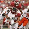 Oklahoma\'s Allen Patrick (23) takes the ball up field past Oklahoma State\'s Ricky Price (6) and Martel Van Zant (7) during the first half of the college football game between the University of Oklahoma Sooners (OU) and the Oklahoma State University Cowboys (OSU) at the Gaylord Family-Memorial Stadium on Saturday, Nov. 24, 2007, in Norman, Okla. Photo By Bryan Terry, The Oklahoman