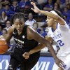 Photo - South Carolina's Aleighsa Welch, left, drives to the basket as Kentucky's Jelleah Sidney defends during the first half of an NCAA college basketball game, Thursday, Feb. 20, 2014, in Lexington, Ky. (AP Photo/James Crisp)