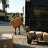 In this March 6, 2012 photo, a UPS worker loads packages in Los Angeles. U.S. employers added 227,000 jobs in February to complete three of the best months of hiring since the recession began. The unemployment rate was unchanged, largely because more people streamed into the work force. The Labor Department said Friday, March 9, 2012, that the unemployment rate stayed at 8.3 percent last month, the lowest in three years. (AP Photo/Damian Dovarganes)
