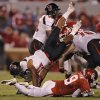 Texas Tech\'s DeAndre Washington (21) is upended by Oklahoma\'s Gabe Lynn (9) during the college football game between the University of Oklahoma Sooners (OU) and Texas Tech University Red Raiders (TTU) at the Gaylord Family-Oklahoma Memorial Stadium on Saturday, Oct. 22, 2011. in Norman, Okla. Photo by Chris Landsberger, The Oklahoman