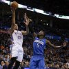 Oklahoma City\'s Thabo Sefolosha (25) shoots a basket as Orlando\'s Victor Oladipo (5) guards during the NBA basketball game between the Oklahoma City Thunder and the Orlando Magic at the Chesapeake Energy Arena, Sunday, Dec. 15, 2013. Photo by Sarah Phipps, The Oklahoman