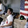 Photo - United States pitcher Carlos Rodon sits in the dugout during the first inning of an exhibition game against Cuba, Thursday, July 18, 2013, in Des Moines, Iowa. (AP Photo/Charlie Neibergall)
