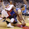 Oklahoma City\'s Nick Collison (4) looks to pass as Miami\'s Dwyane Wade (3) defends during Game 4 of the NBA Finals between the Oklahoma City Thunder and the Miami Heat at American Airlines Arena, Tuesday, June 19, 2012. Photo by Bryan Terry, The Oklahoman
