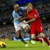 Photo - Manchester City's Maicon, left, fights for the ball against Liverpool's Daniel Agger during their English Premier League soccer match at The Etihad Stadium, Manchester, England, Sunday Feb. 3, 2013. (AP Photo/Jon Super)
