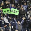 "Photo - Seattle Seahawks fans celebrate with a variation on the New Orleans Saints slogan ""Who Dat?"" in the second half of an NFL football game, Monday, Dec. 2, 2013, in Seattle. The Seahawks beat the Saints 34-7. (AP Photo/Scott Eklund)"
