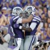 Photo - Kansas State running back Charles Jones, right, and wide receiver Kody Cook celebrate after Jones scored a touchdown during the first half of an NCAA college football game against Stephen F. Austin Saturday, Aug. 30, 2014, in Manhattan, Kan. (AP Photo/Charlie Riedel)