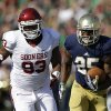 Notre Dame\'s Tarean Folston (25) runs past Oklahoma\'s Jordan Wade (93) during the first half of an NCAA college football game on Saturday, Sept. 28, 2013, in South Bend, Ind. (AP Photo/Darron Cummings) ORG XMIT: INDC107