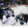 Photo - San Jose Sharks goalie Antti Niemi, right, of Finland, stop a shot next to Winnipeg Jets' Matt Halischuk (15) and teammate Matt Irwin (52) during the second period of an NHL hockey game on Thursday, March 27, 2014, in San Jose, Calif. (AP Photo/Marcio Jose Sanchez)
