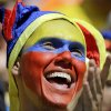 A Colombian supporter applauds before the group C World Cup soccer match between Colombia and Ivory Coast at the Estadio Nacional in Brasilia, Brazil, Thursday, June 19, 2014. (AP Photo/Sergei Grits)
