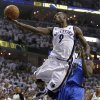 Memphis Grizzlies guard Tony Allen, left, scores against Oklahoma City Thunder forward Serge Ibaka during the first half of Game 4 of a second-round NBA basketball series on Monday, May 9, 2011, in Memphis, Tenn. (AP Photo/Wade Payne)