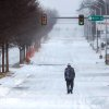A lone man walks in the middle of the eastbound lanes of a snow-covered and deserted NW 23rd Street Tuesday. A severe winter storm created whiteout conditions and caused snow drifts that made problems for the few motorists who ventured out Tuesday afternoon, Feb. 1, 2011. Photo by Jim Beckel, The Oklahoman