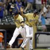Milwaukee Brewers\' Caleb Gindl, left, is congratulated by third base coach Ed Sedar after hitting a walkoff home run during the 13th inning of a baseball game against the Miami Marlins, Sunday, July 21, 2013, in Milwaukee. (AP Photo/Morry Gash)