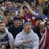 Alex Dubin, 17, center top, reacts with other United States fans while watching the 2014 World Cup soccer match between the United States and Germany at a public viewing party in San Francisco, Thursday, June 26, 2014. (AP Photo/Jeff Chiu)