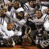 The Star Spencer Bobcats pose for a photo with championship trophy after the Class 4A high school football state championship game between Star Spencer and Douglass at Boone Pickens Stadium in Stillwater, Okla., Saturday, December 5, 2009. Star Spencer won, 34-21. Photo by Nate Billings, The Oklahoman