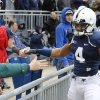 Photo - Penn State cornerback Adrian Amos (4) greets fans before the start of their spring NCAA college football game on Saturday, April 20, 2013, in State College, Pa. (AP Photo/Keith Srakocic)