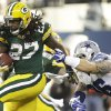Photo - Green Bay Packers running back Eddie Lacy (27) moves away from Dallas Cowboys defensive tackle Nick Hayden (96) during the first half of an NFL football game, Sunday, Dec. 15, 2013, in Arlington, Texas. (AP Photo/Tim Sharp)