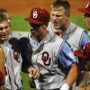 Oklahoma\'s Max White, center, celebrates with teammates Kolbey Carpenter, left, and Colt Beckerstaff, right, during an NCAA college baseball tournament regional game at English Field in Blacksburg, Va., Sunday, June 2, 2013. (AP Photo/Michael Shroyer) ORG XMIT: VAMS160