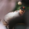 Photo - San Francisco Giants starting pitcher Matt Cain, back, delivers a pitch while framed by Colorado Rockies batter Troy Tulowitzki, front left, and home plate umpire Adam Hamari in the first inning of a baseball game in Denver on Wednesday, May 21, 2014. (AP Photo/David Zalubowski)