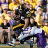 Photo -   Iowa Mark Weisman (45) is hit by Northern Iowa defensive back Garrett Scott (15) after catching a pass out of the backfield during the first half of an college football game Saturday, Sept. 15, 2012 at Kinnick Stadium in Iowa City. (AP Photo/The Gazette, Brian Ray)