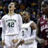 Baylor\'s Brittney Griner (42) reacts after breaking the NCAA women\'s career record for blocks against Oklahoma during the second half of an NCAA college basketball game Saturday, Jan. 26, 2013, in Waco Texas. Also show are Baylor\'s Odyssey Sims (0) and Oklahoma\'s Aaryn Ellenberg (3). (AP Photo/LM Otero) ORG XMIT: TXMO107