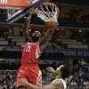Houston Rockets\' James Harden (13) dunks above Charlotte Bobcats\' Gerald Henderson (9) during the second half of an NBA basketball game in Charlotte, N.C., Monday, Jan. 21, 2013. Houston won 100-94. (AP Photo/Chuck Burton)