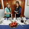 Emanuel Synagogue will host event called Jewish Living Made Beautiful which focuses on many traditions of their faith. Barbara Guskin lights candles while Julie Plotkin reads prayers in front of a traditional Sabbath table setting. Photo by JIM BECKEL, THE OKLAHOMAN