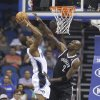 Photo - Orlando Magic's Maurice Harkless, left, make a shot over Brooklyn Nets' Kevin Garnett (2) during the first half of an NBA basketball game in Orlando, Fla., Wednesday, April 9, 2014. (AP Photo/John Raoux)