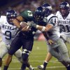 FILE - In this Oct. 9, 2004, file photo, Hawaii\'s Bryan Maneafaiga (43) scores a touchdown against Nevada in Honolulu. With uneven testing for steroids and inconsistent punishment, college football players are packing on significant weight _ in some cases, 30 pounds or more in a single year _ without drawing much attention from their schools or the NCAA in a sport that earns tens of billions of dollars for teams. But looking solely at the most significant weight gainers also ignores players like Maneafaiga. In the summer of 2004, Maneafaiga was an undersized 180-pound running back trying to make the University of Hawaii football team. Twice, once in pre-season and once in the fall, he failed school drug tests, showing up positive for marijuana use. What surprised him was that the same tests turned up negative for steroids. He'd started injecting stanozolol, a steroid, in the summer to help bulk up to a roster weight of 200 pounds. (AP Photo/ Honolulu Star-Advertiser, George F. Lee)