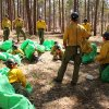 Photo - In this 2012 photo provided by the Cronkite News, Phillip Maldonado, a squad leader with the Granite Mountain Hotshots, trains crew members on setting up emergency fire shelters. On Sunday, June 30, 2013, 19 members of the Prescott, Ariz.-based crew were killed in the deadliest wildfire involving firefighters in the U.S. for at least 30 years. The firefighters were forced to deploy their emergency fire shelters - tent-like structures meant to shield firefighters from flames and heat - when they were caught near the central Arizona town of Yarnell, according to a state forestry spokesman. (AP Photo/Cronkite News, Connor Radnovich)