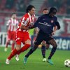 Olympiakos\' Ljubomir Fejsa, left, fights for the ball with Arsenal\'s Gervinho, right, during a group B Champions League soccer match in the port of Piraeus, near Athens, Tuesday, Dec. 4, 2012. (AP Photo/Thanassis Stavrakis)