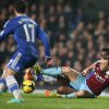 Photo - Chelsea's Mikel, at rear, slides in a tackle with West Ham's Mark Noble during the English Premier League soccer match between Chelsea and West Ham United at Stamford Bridge stadium in London, Wednesday, Jan. 29, 2014.(AP Photo/Alastair Grant)