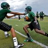 Players take to the field during the opening day of high school football practice at Edmond Santa Fe High School on Monday, Aug. 12, 2013 in Edmond, Okla. Teams from across the state began their practice sessions to prepare for the start of football season. Photo by Chris Landsberger, The Oklahoman