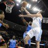 Denver Nuggets forward Danilo Gallinari (8) from Italy goes up for a shot against Oklahoma City Thunder forward Serge Ibaka (9) from the Republic of Congo during the second half of game 3 of a first-round NBA basketball playoff series Saturday, April 23, 2011, in Denver. (AP Photo/Jack Dempsey)