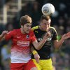Photo - CORRECTS IDENTITY OF FREIBURG'S PLAYER AT LEFT TO PHILIPP ZULECHNER - Freiburg's Philipp Zulechner,  left, challenges for the ball with Dortmund's Kevin Großkreutz during the German first division Bundesliga soccer match between SC Freiburg and Borussia Dortmund in Freiburg, Germany, Sunday March 9, 2014.  (AP Photo/dpa, Patrick Seeger)