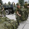 Military reserves arrive to assist with flood preparation at Southport, Manitoba, Saturday, July 5, 2014. Tropical storm Arthur hit Canada\'s Maritime provinces with near-hurricane strength winds and torrential rains, knocking out power to nearly 200,000 customers. (AP Photo/The Canadian Press, John Woods)