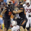 Oklahoma State\'s Richetti Jones (99) and Cooper Bassett (80) celebrate Jones\' sack on Stanford\'s Andrew Luck (12) during the Fiesta Bowl between the Oklahoma State University Cowboys (OSU) and the Stanford Cardinal at the University of Phoenix Stadium in Glendale, Ariz., Monday, Jan. 2, 2012. Photo by Sarah Phipps, The Oklahoman