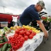 Randy Peters with Dennis Farms of Blanchard, hangs price tags for vegetables at the Farmer\'s Market at the Cleveland County Fairgrounds on Wednesday, April 17, 2013 in Norman, Okla. Photo by Steve Sisney, The Oklahoman