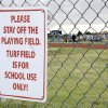 Signs warn individuals to stay off the premises of the athletic facilities at Edmond North High School in Edmond, OK, Tuesday, July 21, 2009. School officials said the fields and equipment were being used by people without permission and vandals have also caused more than $18,000 worth of damages to track and field equipment. By Paul Hellstern, The Oklahoman