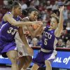 Oklahoma Sooners\' DaShawn Harden (22) tries to drive between Briesha Wynn (33) and Meagan Henson in the second half as the University of Oklahoma (OU) Sooners defeated the Texas Christian University (TCU) Horned Frogs 82-54 in women\'s college basketball at the Lloyd Noble Center on Wednesday, Dec. 28, 2011, in Norman, Okla. Photo by Steve Sisney, The Oklahoman